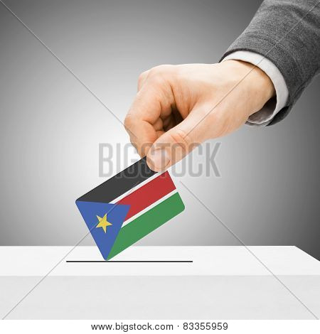 Voting Concept - Male Inserting Flag Into Ballot Box - South Sudan