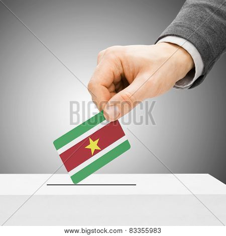 Voting Concept - Male Inserting Flag Into Ballot Box - Suriname