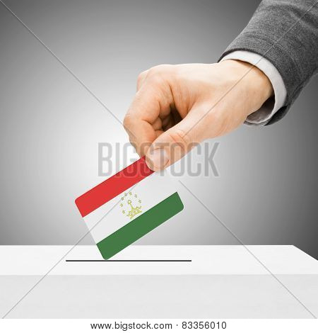 Voting Concept - Male Inserting Flag Into Ballot Box - Tajikistan