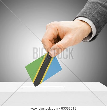 Voting Concept - Male Inserting Flag Into Ballot Box - Tanzania
