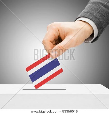 Voting Concept - Male Inserting Flag Into Ballot Box - Thailand