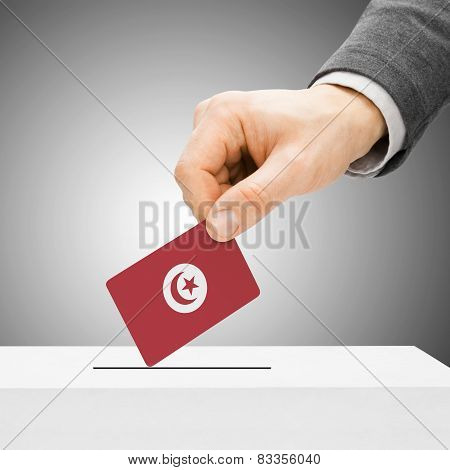 Voting Concept - Male Inserting Flag Into Ballot Box - Tunisia