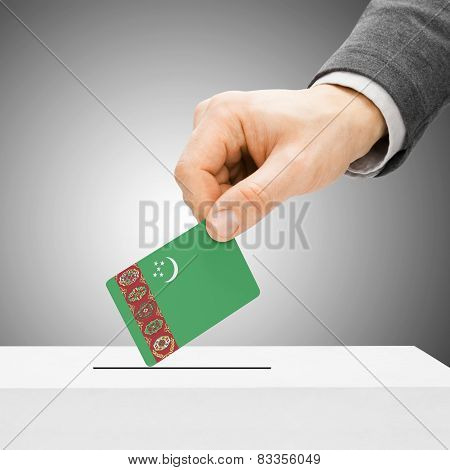 Voting Concept - Male Inserting Flag Into Ballot Box - Turkmenistan