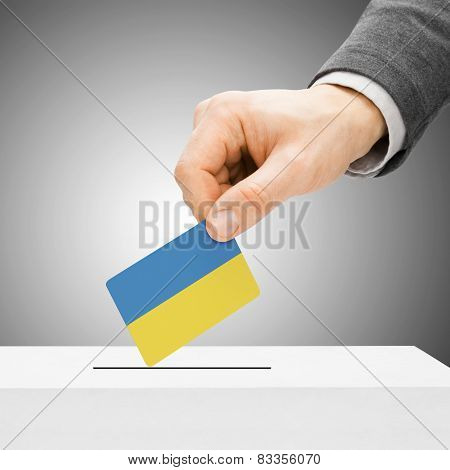 Voting Concept - Male Inserting Flag Into Ballot Box - Ukraine