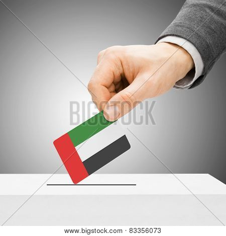Voting Concept - Male Inserting Flag Into Ballot Box - United Arab Emirates