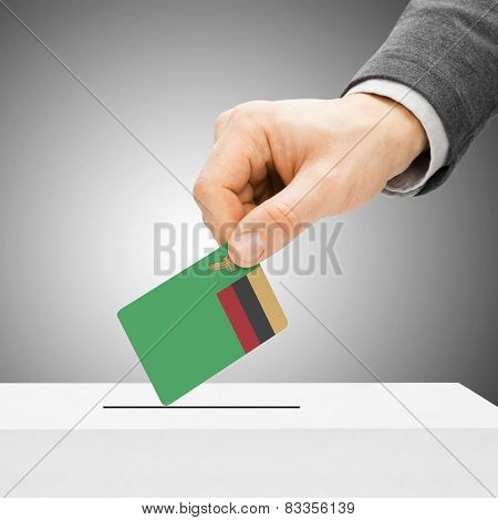 Voting Concept - Male Inserting Flag Into Ballot Box - Zambia