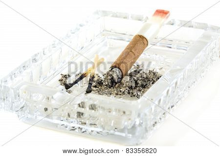 Cigarette Butt With Red Lipstick In The Ashtray.