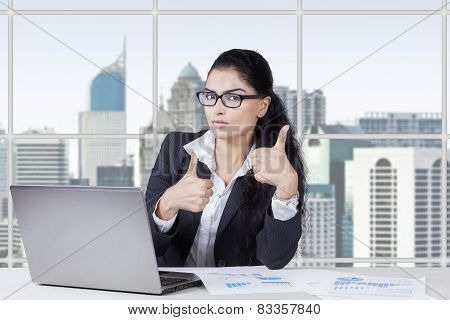 Attractive Woman With Thumbs Up In Office