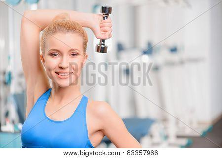 Beautiful girl in sports club