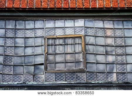 Artsy windows in an old building