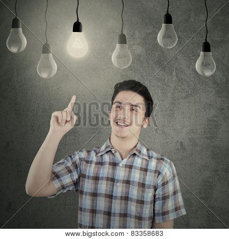 Caucasian Person Under Lightbulb