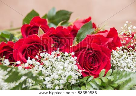 Baby's Breath And Red Roses