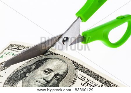 dollar bills and scissors