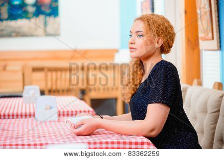 Beautiful woman in the cafe
