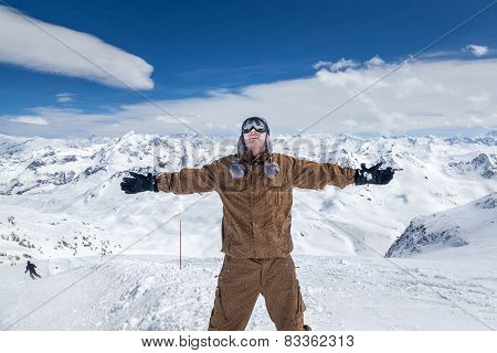 Happy Snowboarder In High Mountains