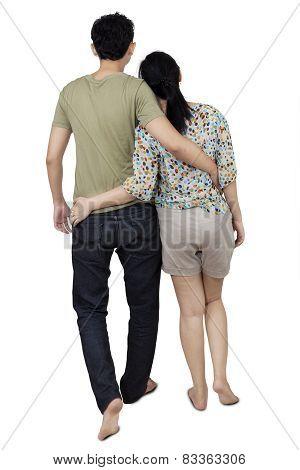Rear View Couple Walking In Studio