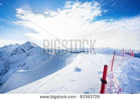 Beautiful Caucasus mountains with fence during day
