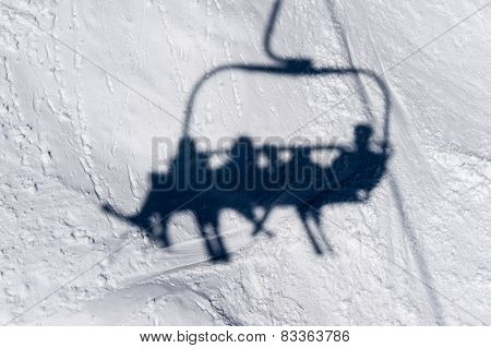 Shadow Of Skiers On Lift Chair