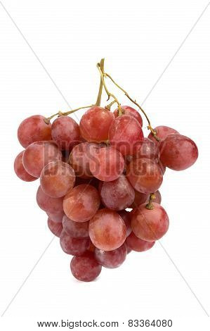 a bunch of red grape on black styrofoam with isolated white background