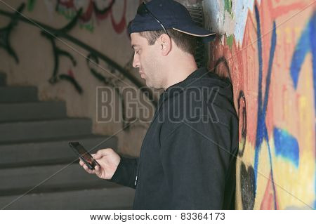 Drug dealer in a tunnel. A dark place to deal person.