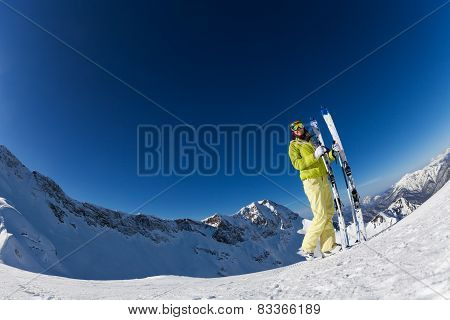 Fisheye view of young woman in mask holding ski