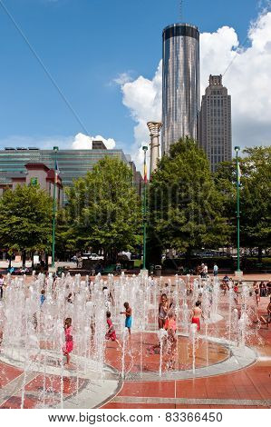 Kids And Families Enjoy Playing In Atlanta Centennial Park Fountain