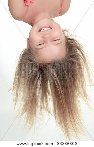 Studio Portrait Of Young Girl upside down