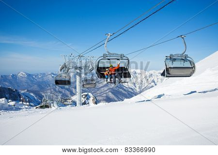 Skiers on the chairlift ropeway winter resort