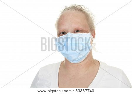 A chemotherapy woman wearing a medical mask.
