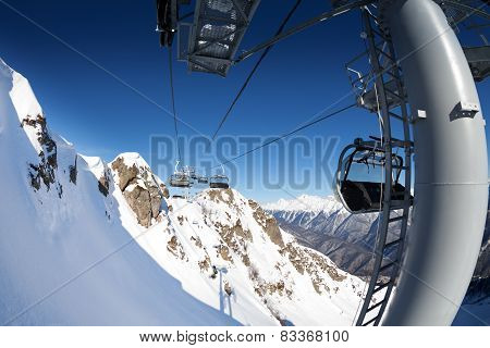 Ski lift panorama on winter resort over valley
