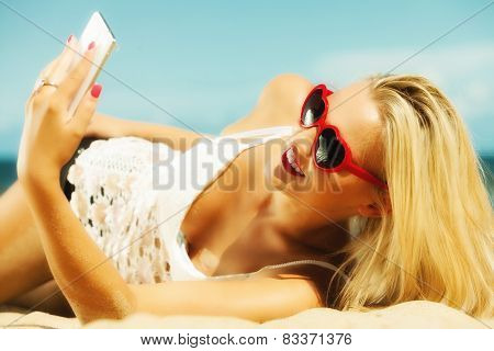Woman With Mobile Phone On Beach