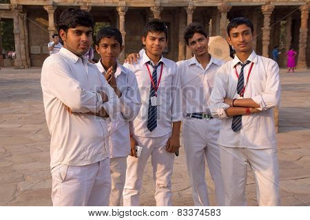 Delhi, India - November 4: Unidentified Teenagers Stand In Quwwat-ul-islam Mosque Courtyard At Qutub
