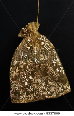Golden Pouch With Flower Patterns On Black