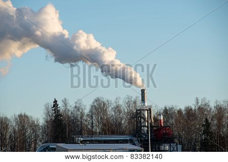 Industrial Park With Chimney And White Smoke