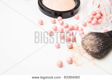 the bronzing pearls and makeup brush.