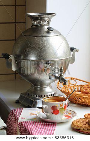 Tea With A Lemon And Cookies And A Samovar