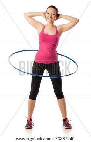 fitness woman working with hula hoop smiling isolated over white