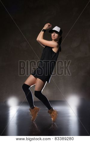 Sexy young woman in a trendy clothes over black background