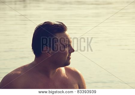 Man Relaxing at the sea at sunny day. Toned