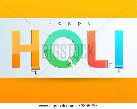 Glossy colorful text Holi drawn by paint roller brush on grey background for Indian festival of colors celebration.