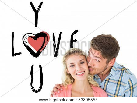 Handsome man kissing girlfriend on cheek against cute valentines message