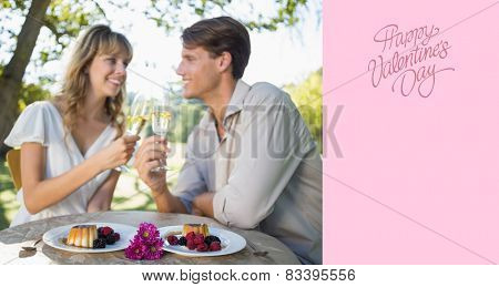 Cute happy couple sitting outside toasting with champagne with dessert against happy valentines day