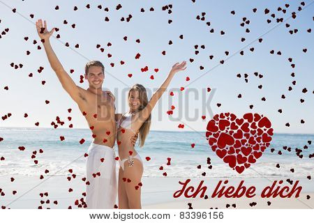 Happy couple smiling at camera and waving against ich liebe dich