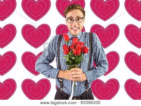 Geeky hipster holding a bunch of roses against valentines day pattern