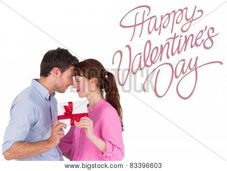 Loving couple holding a gift against cute valentines message