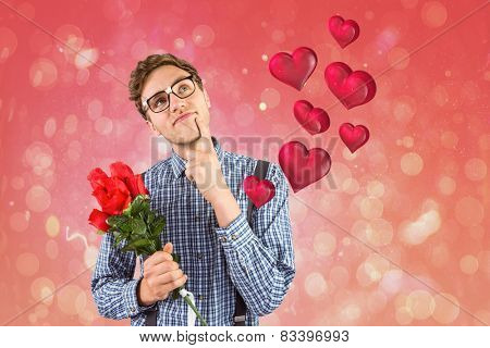 Geeky hipster holding a bunch of roses against red abstract light spot design
