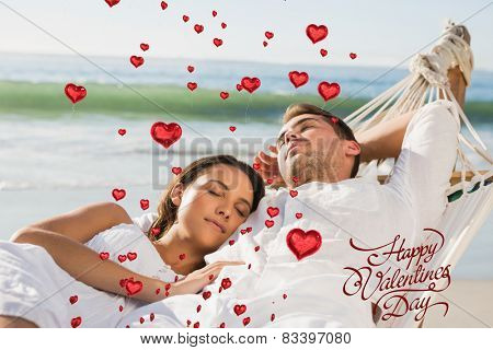 Peaceful couple napping in a hammock against happy valentines day