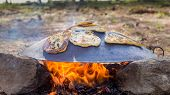 "stock photo of pita  - ""Tabun"" a traditional way of making daruze pita bread outdoors - JPG"