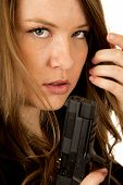 pic of pistols  - Female model holding pistol close up serious - JPG