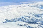image of italian alps  - View of the Italian Alps from an airplane window - JPG